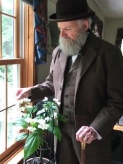 Kenneth Noll portraying Charles Darwin